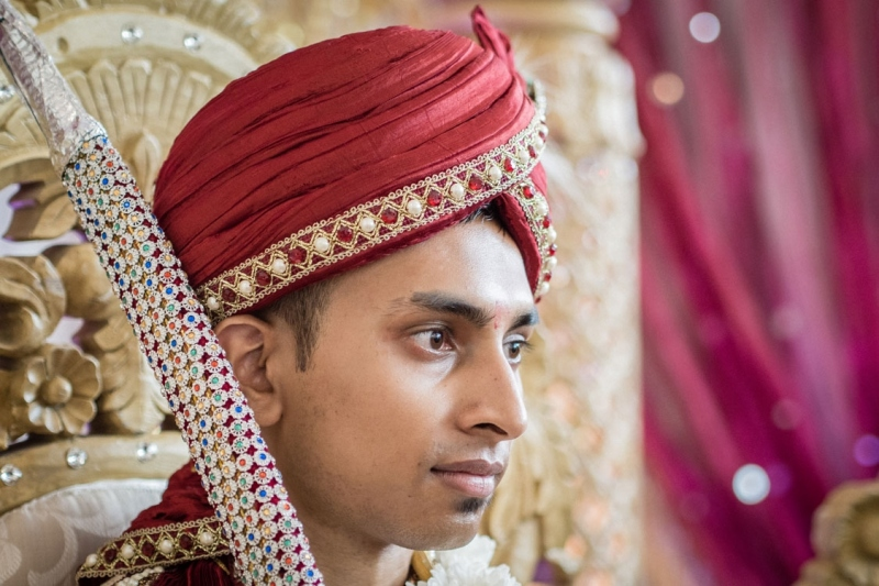 groom-in-mandap-with-sword