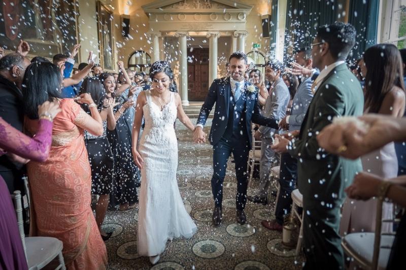 asian-wedding-couple-walking-through-confetti