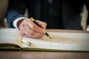 groom-signing-registry-book